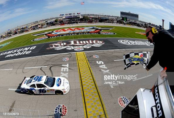Trevor Bayne driver of the RickyVsTrevorcom Ford crosses the start finish line to take the checkered flag and win the the NASCAR Nationwide Series...