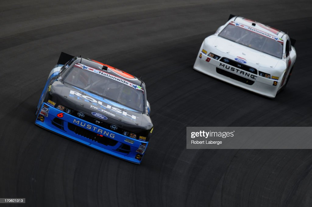 Trevor Bayne driver of the Roush CleanTech Ford leads Scott Riggs driver of the Rick Ware Racing Ford during the NASCAR Nationwide Series Alliance...