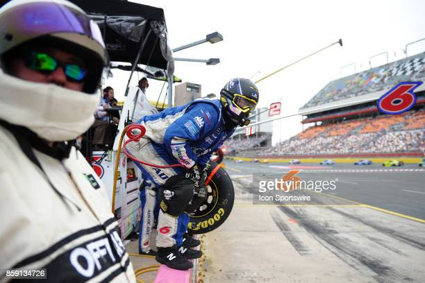 Trevor Bayne Roush Fenway Racing AdvoCare Ford Fusion rear tire man waits on pit wall for his driver to hit the pit box during the Monster Energy...