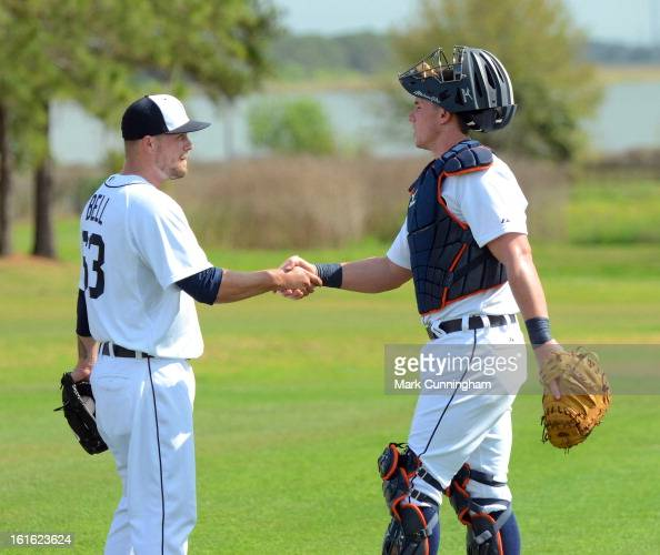 Trevor Bell and James McCann of the Detroit Tigers shake hands during Spring Training workouts at the TigerTown Facility on February 12 2013 in...