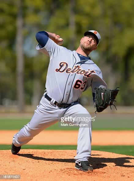 Trevor Bell of the Detroit Tigers pitches during Spring Training workouts at the TigerTown Facility on February 17 2013 in Lakeland Florida