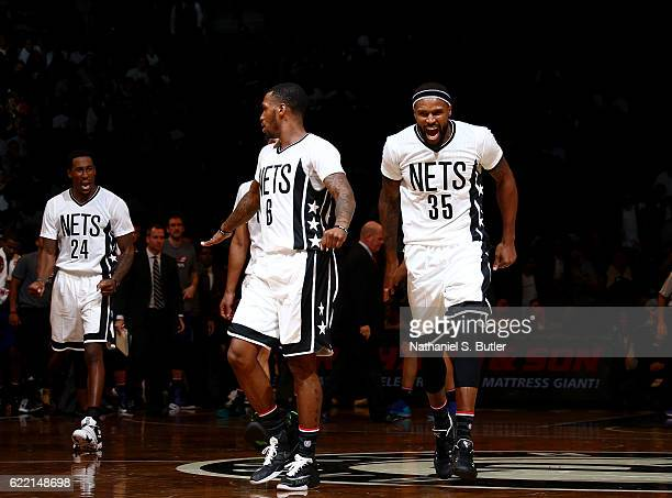 Trevor Booker and Rondae HollisJefferson of the Brooklyn Nets react and yell during a game between the Charlotte Hornets and the Brooklyn Nets on...