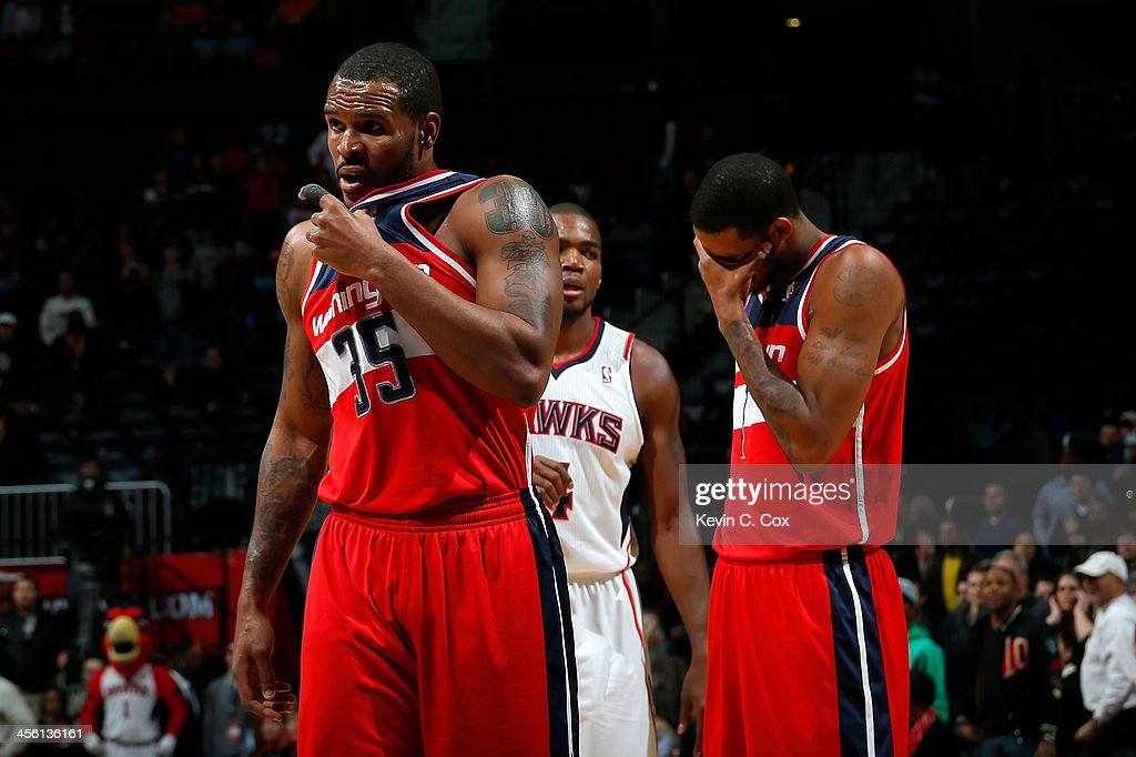 <a gi-track='captionPersonalityLinkClicked' href=/galleries/search?phrase=Trevor+Booker&family=editorial&specificpeople=4123563 ng-click='$event.stopPropagation()'>Trevor Booker</a> #35 and <a gi-track='captionPersonalityLinkClicked' href=/galleries/search?phrase=Trevor+Ariza&family=editorial&specificpeople=201708 ng-click='$event.stopPropagation()'>Trevor Ariza</a> #1 of the Washington Wizards react after a timeout in the final minutes of regulation of their 101-99 overtime loss to the Atlanta Hawks at Philips Arena on December 13, 2013 in Atlanta, Georgia.
