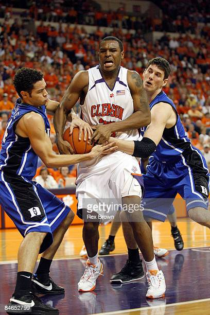 Trevor Booker of the Clemson Tigers battles Brian Zoubek and David McClure of the Duke Blue Devils for this loose ball at Littlejohn Coliseum on...