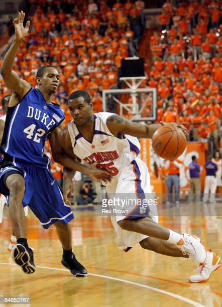 Trevor Booker of the Clemson Tigers works to drive past Lance Thomas of the Duke Blue Devils during the second half at Littlejohn Coliseum on...