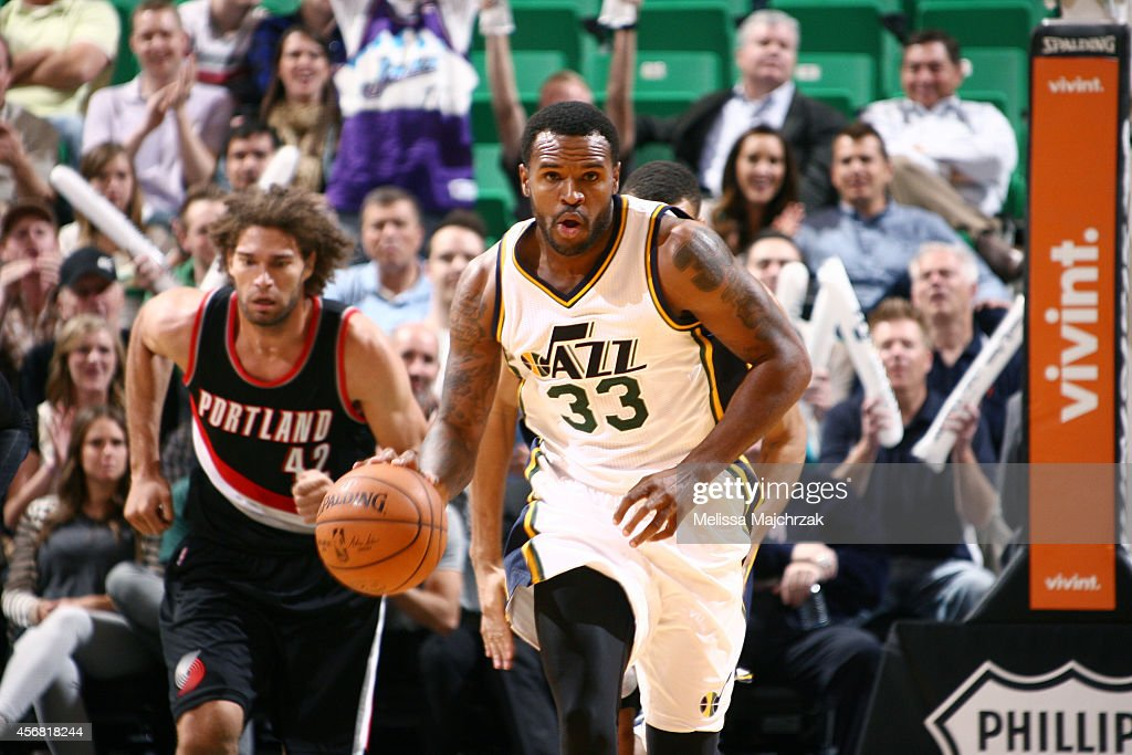 Trevor Booker of the Utah Jazz drives against the Portland Trail Blazers at EnergySolutions Arena on October 7 2014 in Salt Lake City Utah NOTE TO...