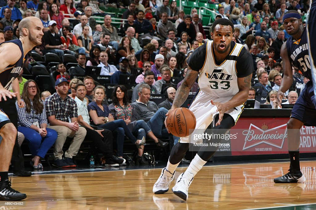 Trevor Booker of the Utah Jazz drives to the basket against the Memphis Grizzlies during the game on April 10 2015 at EnergySolutions Arena in Salt...