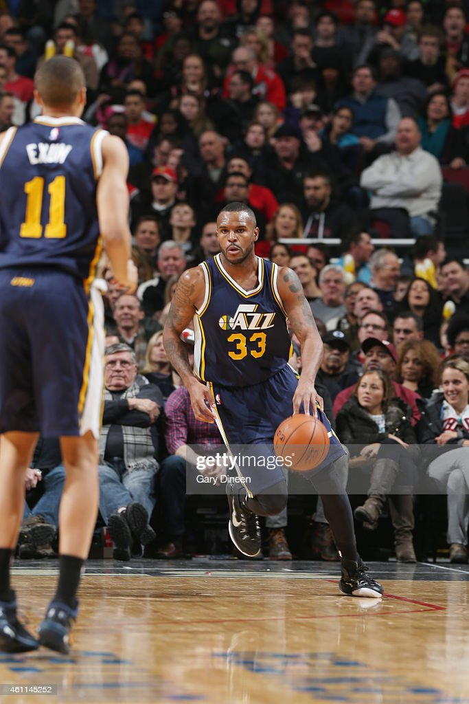 Trevor Booker of the Utah Jazz drives to the basket against the Chicago Bulls during the game on January 7 2015 at United Center in Chicago Illinois...