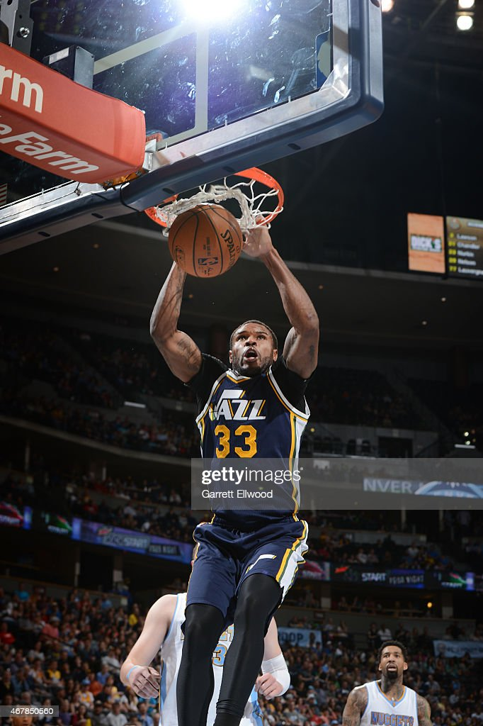Trevor Booker of the Utah Jazz dunks against the Denver Nuggets during the game on March 27 2015 at Pepsi Center in Denver Colorado NOTE TO USER User...