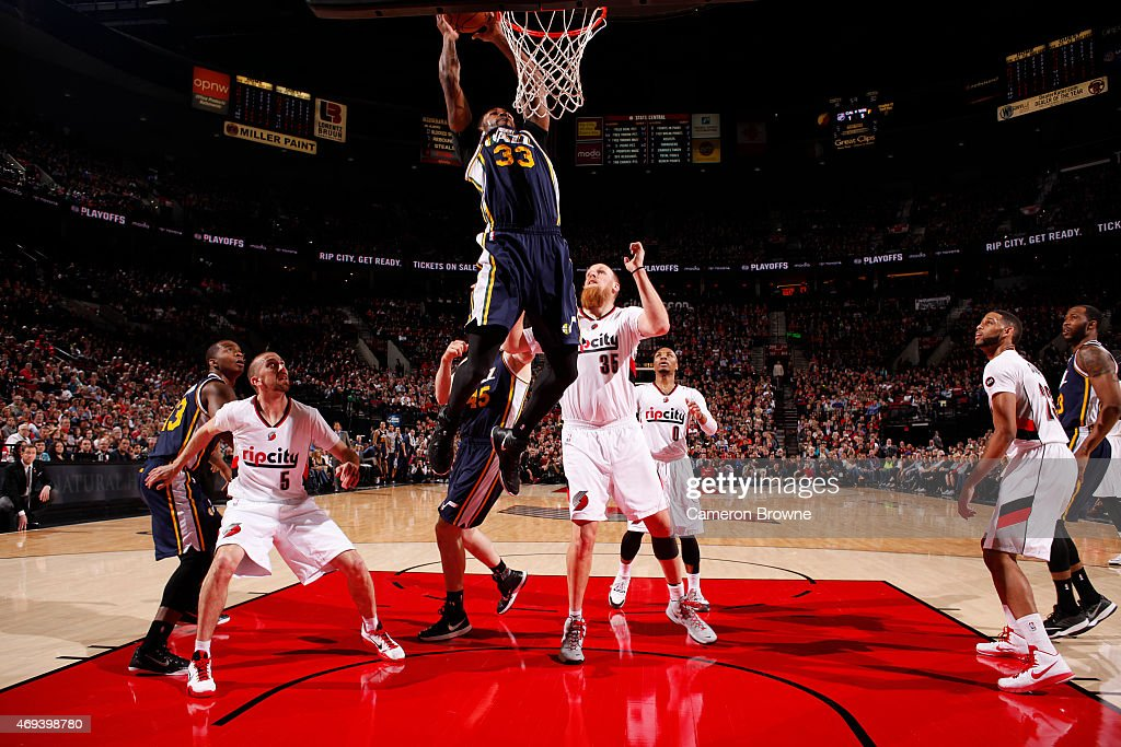 Trevor Booker of the Utah Jazz dunks against the Portland Trail Blazers on April 11 2015 at the Moda Center Arena in Portland Oregon NOTE TO USER...