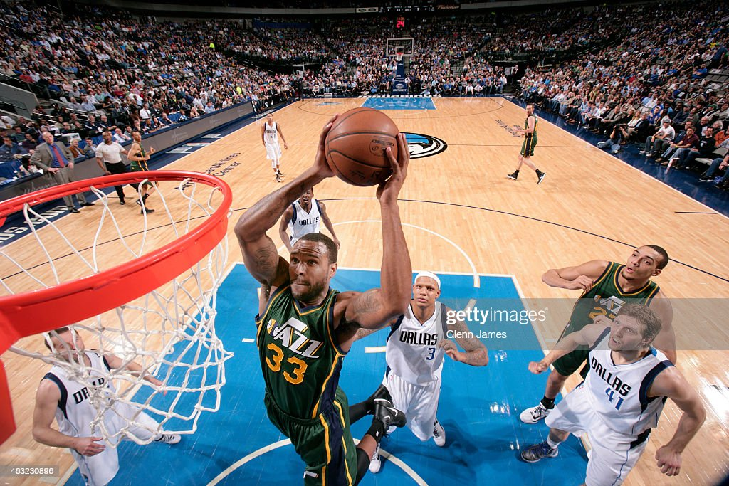 Trevor Booker of the Utah Jazz goes in for the dunk against the Dallas Mavericks on February 11 2015 at the American Airlines Center in Dallas Texas...