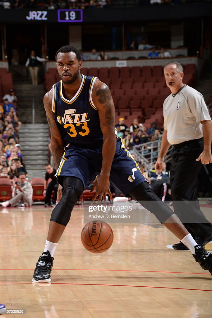 Trevor Booker of the Utah Jazz handles the basketball during a game against the Los Angeles Lakers at Honda Center on October 16 2014 in Anaheim...