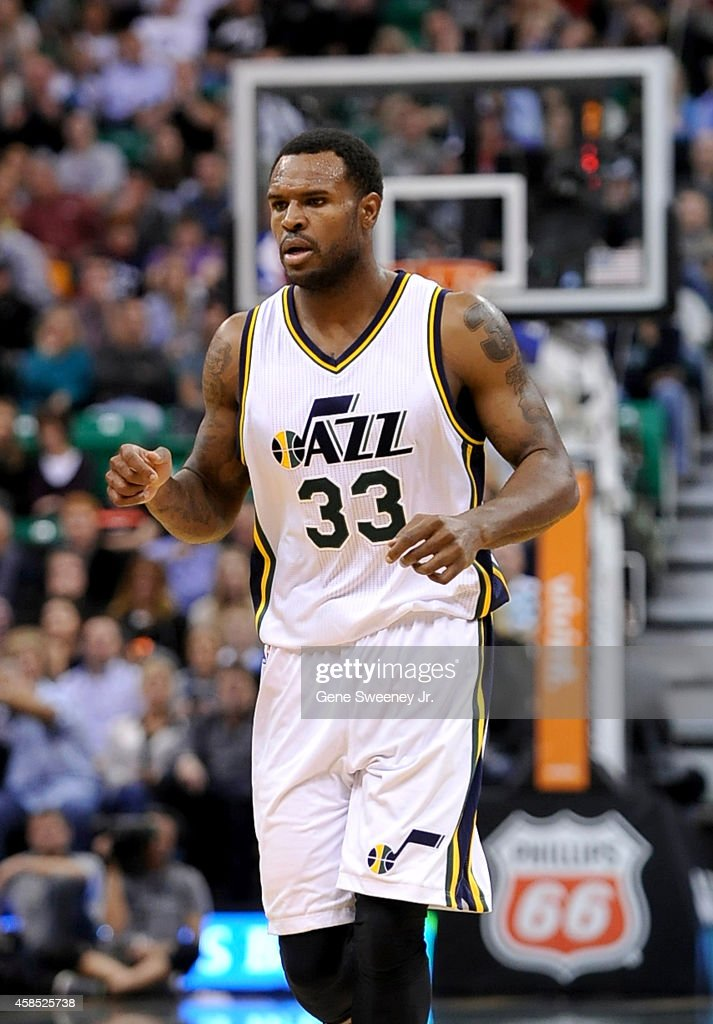 Trevor Booker of the Utah Jazz jogs up court during their game against the Cleveland Cavaliers at EnergySolutions Arena on November 5 2014 in Salt...