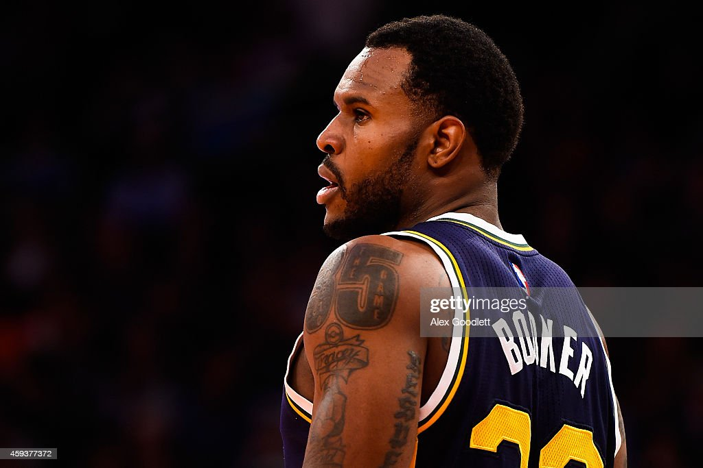 Trevor Booker of the Utah Jazz looks on during a game against the New York Knicks at Madison Square Garden on November 14 2014 in New York City NOTE...