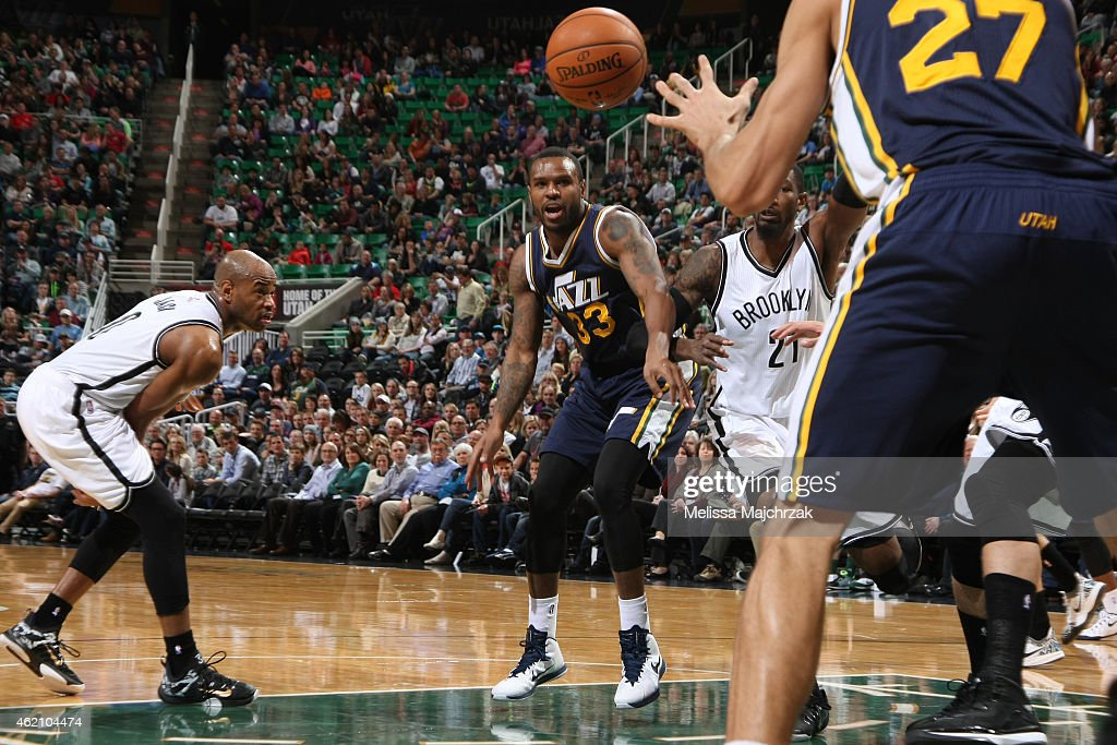 Trevor Booker of the Utah Jazz passes the ball against the Brooklyn Nets during the game on January 24 2015 at EnergySolutions Arena in Salt Lake...