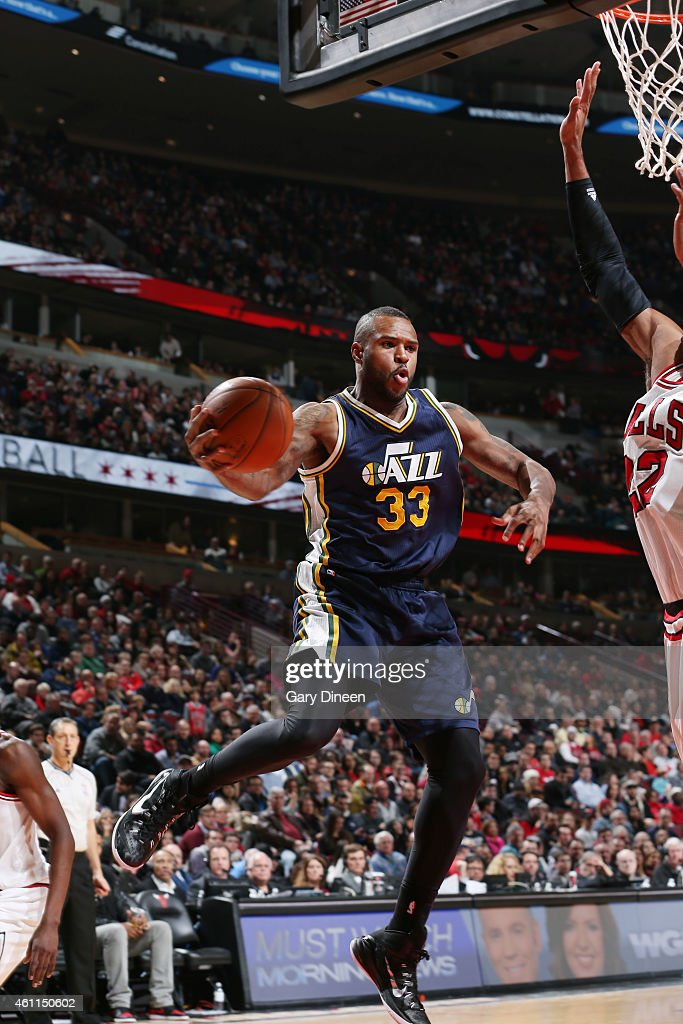 Trevor Booker of the Utah Jazz recovers the rebound against the Chicago Bulls during the game on January 7 2015 at United Center in Chicago Illinois...