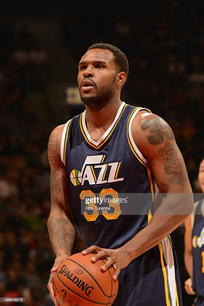 Trevor Booker of the Utah Jazz shoots a free throw against the Toronto Raptors during the game on November 15 2014 at the Air Canada Centre in...