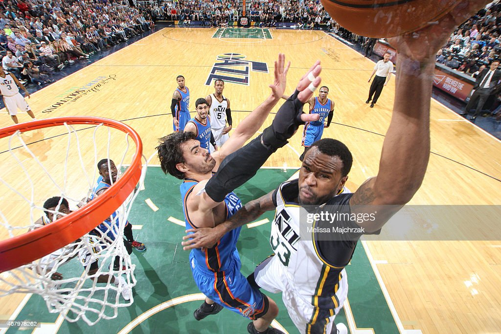 Trevor Booker of the Utah Jazz shoots against Steven Adams of the Oklahoma City Thunder on March 28 2015 at EnergySolutions Arena in Salt Lake City...