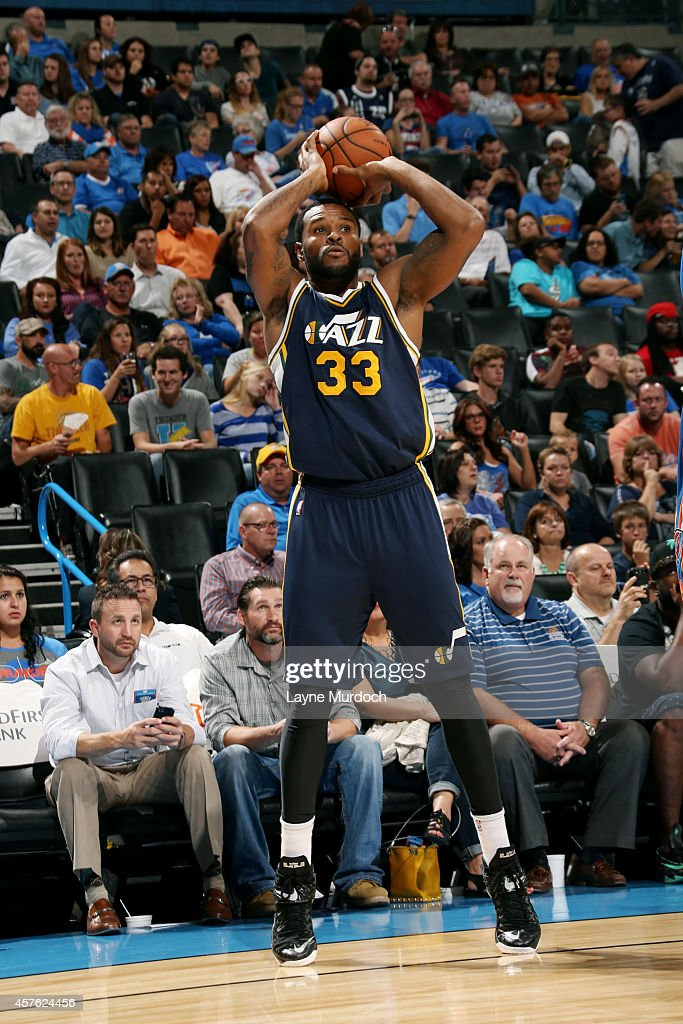 Trevor Booker of the Utah Jazz shoots against the Oklahoma City Thunder on October 21 2014 at Chesapeake Energy Arena in Oklahoma City OK NOTE TO...