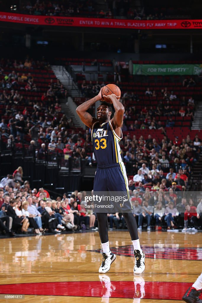 Trevor Booker of the Utah Jazz shoots against the Portland Trail Blazers on October 9 2014 at the Moda Center in Portland Oregon NOTE TO USER User...