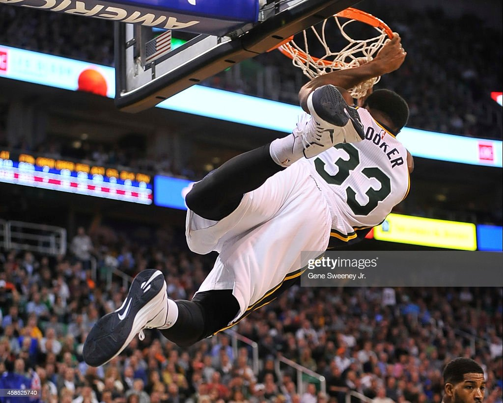 Trevor Booker of the Utah Jazz swings on the basket during their game against the Cleveland Cavaliers at EnergySolutions Arena on November 5 2014 in...