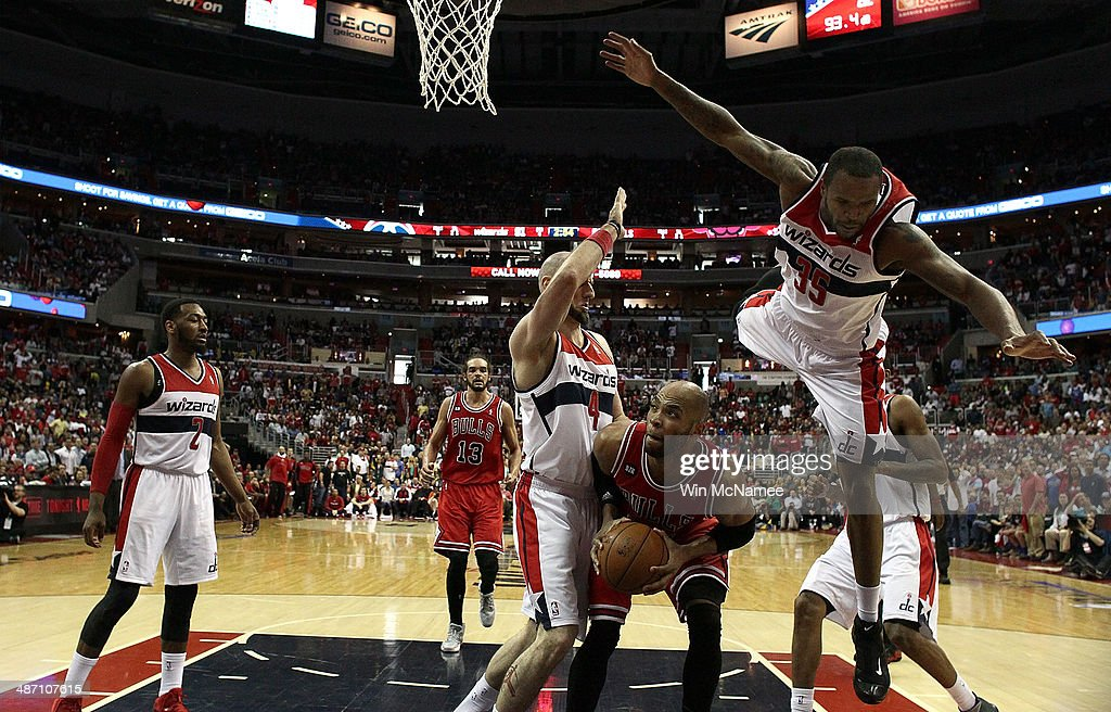 <a gi-track='captionPersonalityLinkClicked' href=/galleries/search?phrase=Trevor+Booker&family=editorial&specificpeople=4123563 ng-click='$event.stopPropagation()'>Trevor Booker</a> #35 of the Washington Wizards and teammate <a gi-track='captionPersonalityLinkClicked' href=/galleries/search?phrase=Marcin+Gortat&family=editorial&specificpeople=589986 ng-click='$event.stopPropagation()'>Marcin Gortat</a> #4 guard <a gi-track='captionPersonalityLinkClicked' href=/galleries/search?phrase=Taj+Gibson&family=editorial&specificpeople=4029461 ng-click='$event.stopPropagation()'>Taj Gibson</a> #22 of the Chicago Bulls in Game Four of the Eastern Conference Quarterfinals during the 2014 NBA Playoffs at the Verizon Center on April 27, 2014 in Washington, DC. Washington won the game 98-89.