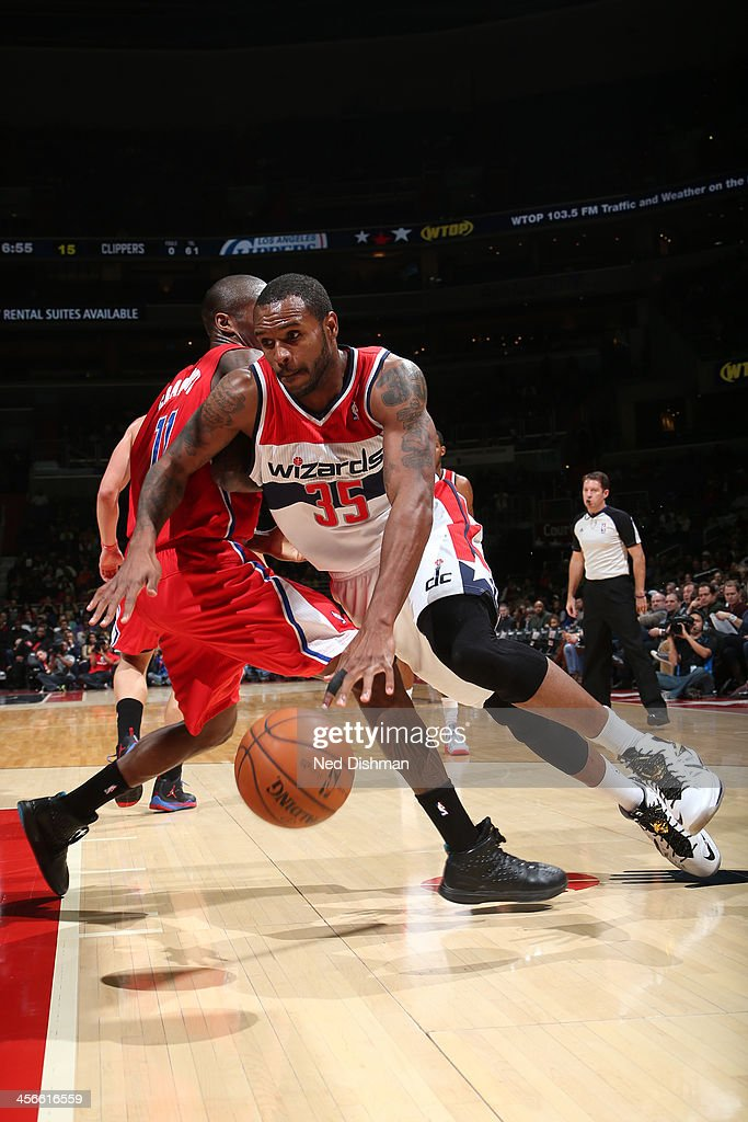 <a gi-track='captionPersonalityLinkClicked' href=/galleries/search?phrase=Trevor+Booker&family=editorial&specificpeople=4123563 ng-click='$event.stopPropagation()'>Trevor Booker</a> #35 of the Washington Wizards drives against Jamal Crawford #11 of the Los Angeles Clippers during the game at the Verizon Center on December 14, 2013 in Washington, DC.