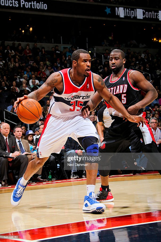 Trevor Booker #35 of the Washington Wizards drives against <a gi-track='captionPersonalityLinkClicked' href=/galleries/search?phrase=Raymond+Felton&family=editorial&specificpeople=209141 ng-click='$event.stopPropagation()'>Raymond Felton</a> #5 of the Portland Trail Blazers at the Verizon Center on March 10, 2012 in Washington, DC.