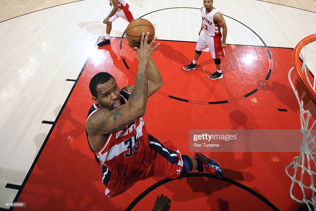 <a gi-track='captionPersonalityLinkClicked' href=/galleries/search?phrase=Trevor+Booker&family=editorial&specificpeople=4123563 ng-click='$event.stopPropagation()'>Trevor Booker</a> #35 of the Washington Wizards drives to the basket against the Toronto Raptors on April 3, 2013 at the Air Canada Centre in Toronto, Ontario, Canada.