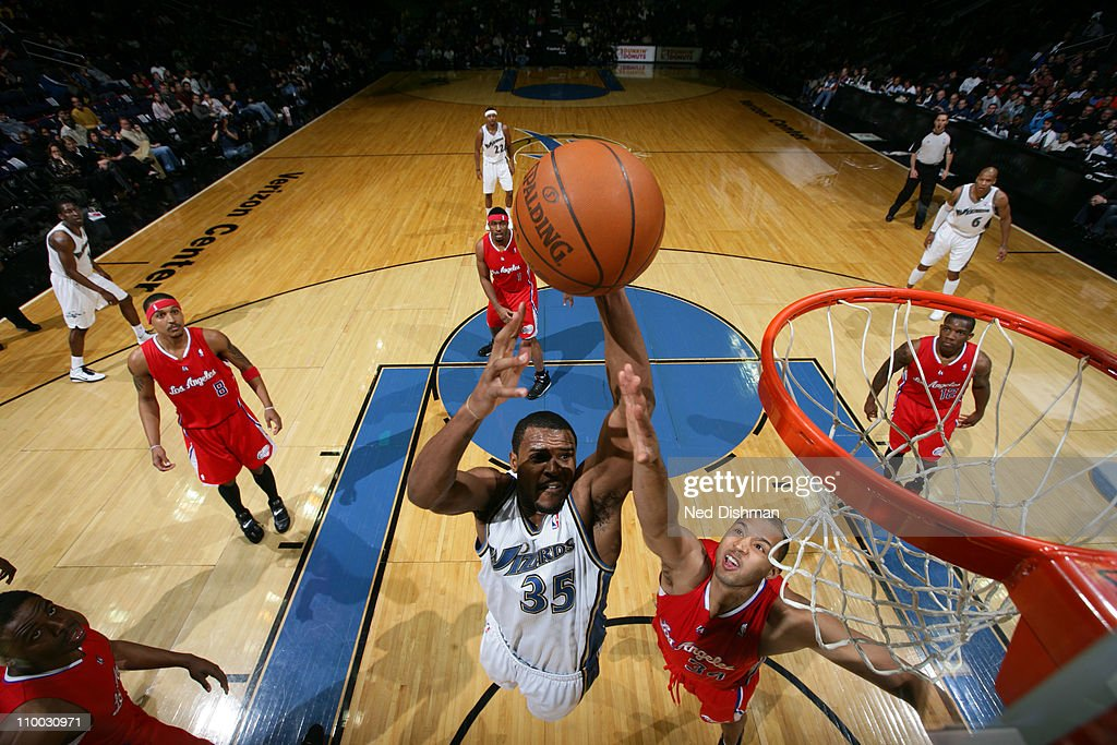 Trevor Booker #35 of the Washington Wizards dunks against <a gi-track='captionPersonalityLinkClicked' href=/galleries/search?phrase=Brian+Cook+-+Basketball+Player&family=editorial&specificpeople=202839 ng-click='$event.stopPropagation()'>Brian Cook</a> #34 of the Los Angeles Clippers at the Verizon Center on March 12, 2011 in Washington, DC.