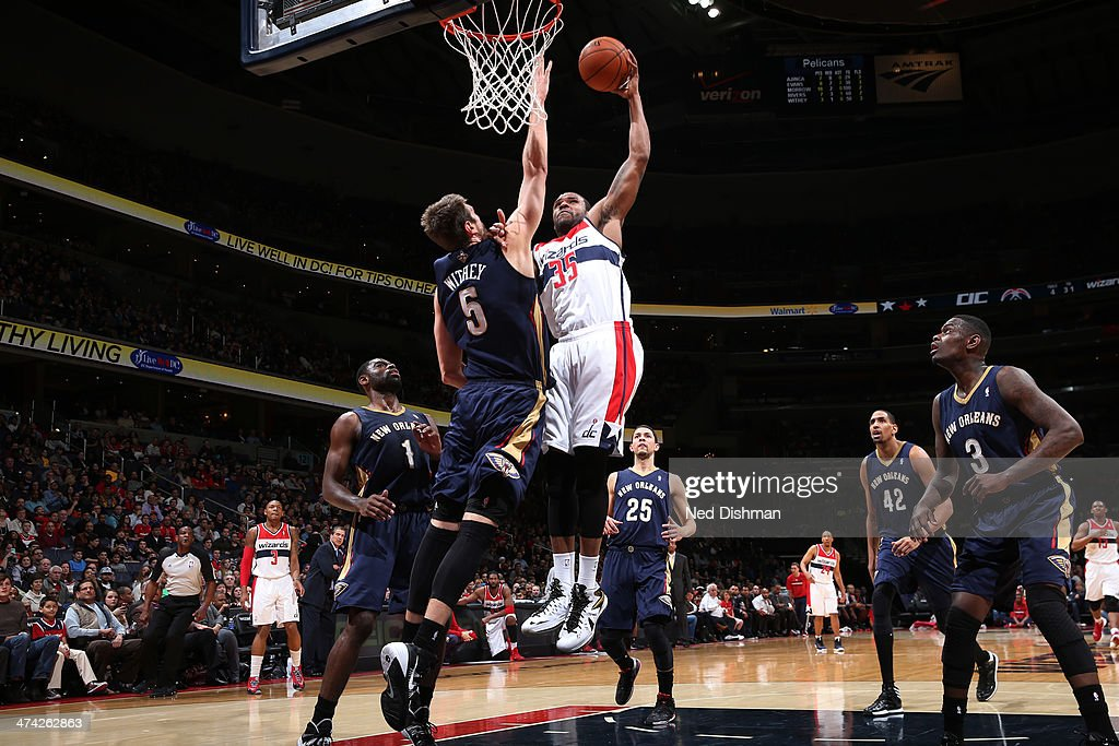 <a gi-track='captionPersonalityLinkClicked' href=/galleries/search?phrase=Trevor+Booker&family=editorial&specificpeople=4123563 ng-click='$event.stopPropagation()'>Trevor Booker</a> #35 of the Washington Wizards dunks against Jeff Withey #5 of the New Orleans Pelicans during the game at the Verizon Center on February 22, 2014 in Washington, DC.