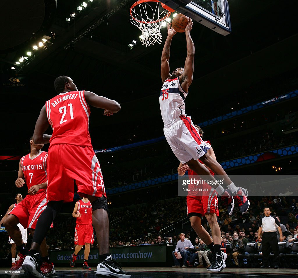 Trevor Booker #35 of the Washington Wizards dunks against Samuel Dalembert #21 of the Houston Rockets during the game at the Verizon Center on January 16, 2012 in Washington, DC.