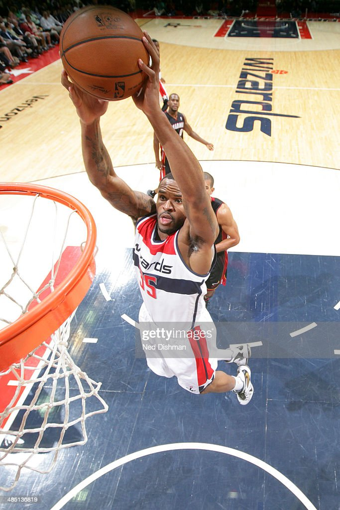 <a gi-track='captionPersonalityLinkClicked' href=/galleries/search?phrase=Trevor+Booker&family=editorial&specificpeople=4123563 ng-click='$event.stopPropagation()'>Trevor Booker</a> #35 of the Washington Wizards dunks against the Washington Wizards at the Verizon Center on April 14, 2014 in Washington, DC.