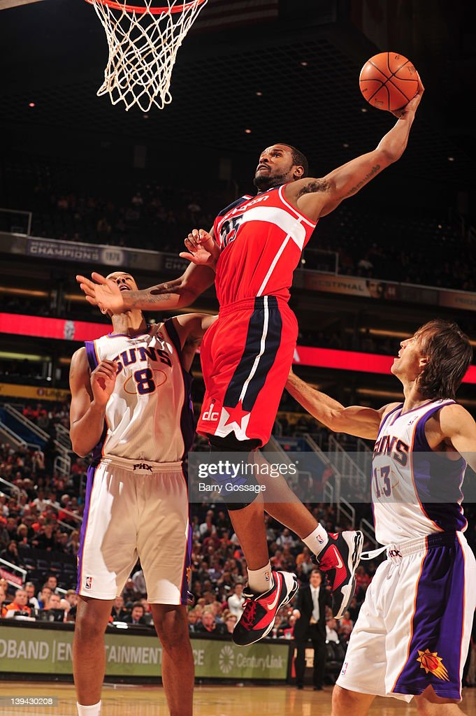 Trevor Booker #35 of the Washington Wizards dunks over <a gi-track='captionPersonalityLinkClicked' href=/galleries/search?phrase=Channing+Frye&family=editorial&specificpeople=206815 ng-click='$event.stopPropagation()'>Channing Frye</a> #8 and <a gi-track='captionPersonalityLinkClicked' href=/galleries/search?phrase=Steve+Nash&family=editorial&specificpeople=201513 ng-click='$event.stopPropagation()'>Steve Nash</a> #13 of the Phoenix Suns on February 20, 2012 at U.S. Airways Center in Phoenix, Arizona.