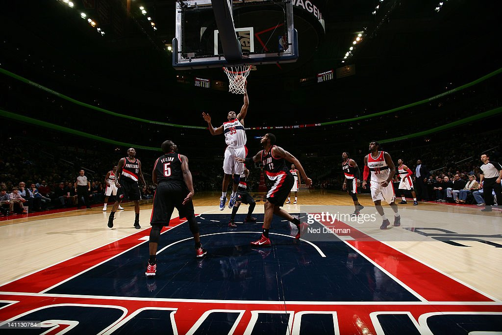 Trevor Booker #35 of the Washington Wizards goes to the basket against <a gi-track='captionPersonalityLinkClicked' href=/galleries/search?phrase=LaMarcus+Aldridge&family=editorial&specificpeople=453277 ng-click='$event.stopPropagation()'>LaMarcus Aldridge</a> #12 and <a gi-track='captionPersonalityLinkClicked' href=/galleries/search?phrase=Raymond+Felton&family=editorial&specificpeople=209141 ng-click='$event.stopPropagation()'>Raymond Felton</a> #5 of the Portland Trail Blazers at the Verizon Center on March 10, 2012 in Washington, DC.