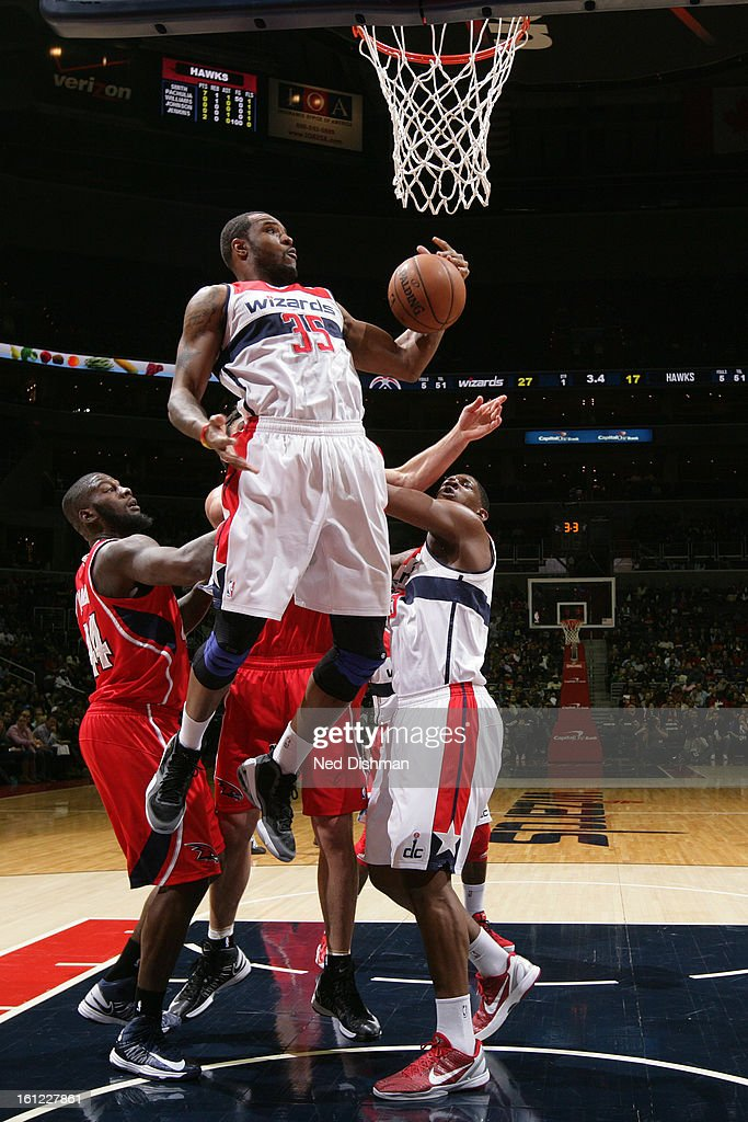 Trevor Booker #35 of the Washington Wizards grabs a rebound against the Atlanta Hawks during the game at the Verizon Center on January 12, 2013 in Washington, DC.