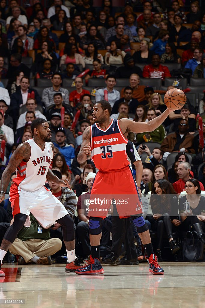 Trevor Booker #35 of the Washington Wizards palms the ball while looking to pass against Amir Johnson #35 of the Toronto Raptors during the game on April 3, 2013 at the Air Canada Centre in Toronto, Ontario, Canada.