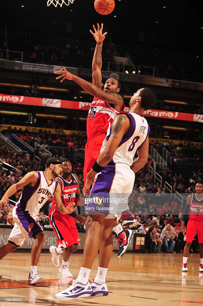 Trevor Booker #35 of the Washington Wizards puts a shot up over <a gi-track='captionPersonalityLinkClicked' href=/galleries/search?phrase=Channing+Frye&family=editorial&specificpeople=206815 ng-click='$event.stopPropagation()'>Channing Frye</a> #8 of the Phoenix Suns on February 20, 2012 at U.S. Airways Center in Phoenix, Arizona.