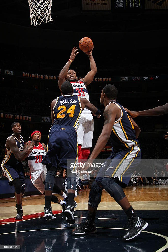 <a gi-track='captionPersonalityLinkClicked' href=/galleries/search?phrase=Trevor+Booker&family=editorial&specificpeople=4123563 ng-click='$event.stopPropagation()'>Trevor Booker</a> #35 of the Washington Wizards puts up a shot over <a gi-track='captionPersonalityLinkClicked' href=/galleries/search?phrase=Paul+Millsap&family=editorial&specificpeople=880017 ng-click='$event.stopPropagation()'>Paul Millsap</a> #24 of the Utah Jazz at the Verizon Center on November 17, 2012 in Washington, DC.
