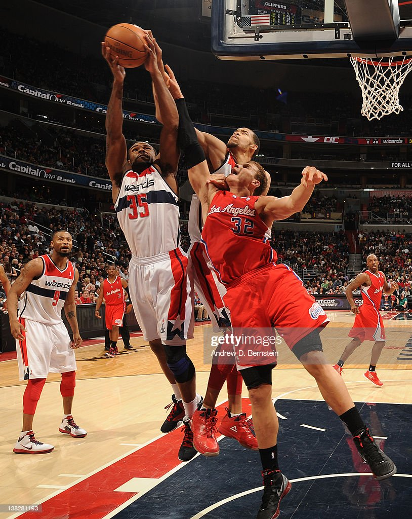 Trevor Booker #35 of the Washington Wizards rebounds against <a gi-track='captionPersonalityLinkClicked' href=/galleries/search?phrase=Blake+Griffin+-+Basketball+Player&family=editorial&specificpeople=4216010 ng-click='$event.stopPropagation()'>Blake Griffin</a> #32 of the Los Angeles Clippers during the game at the Verizon Center on February 4, 2012 in Washington, DC.
