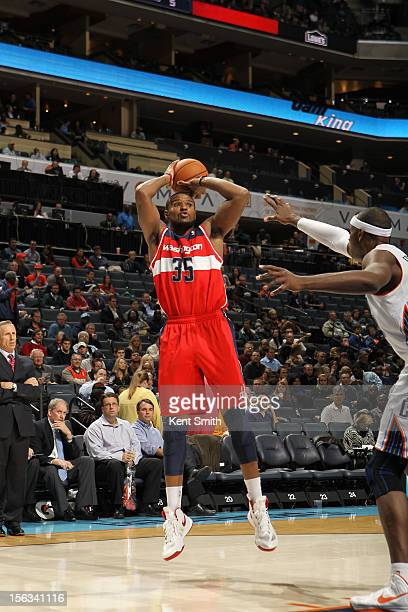 Trevor Booker of the Washington Wizards shoots against Brendan Haywood of the Charlotte Bobcats at the Time Warner Cable Arena on November 13 2012 in...