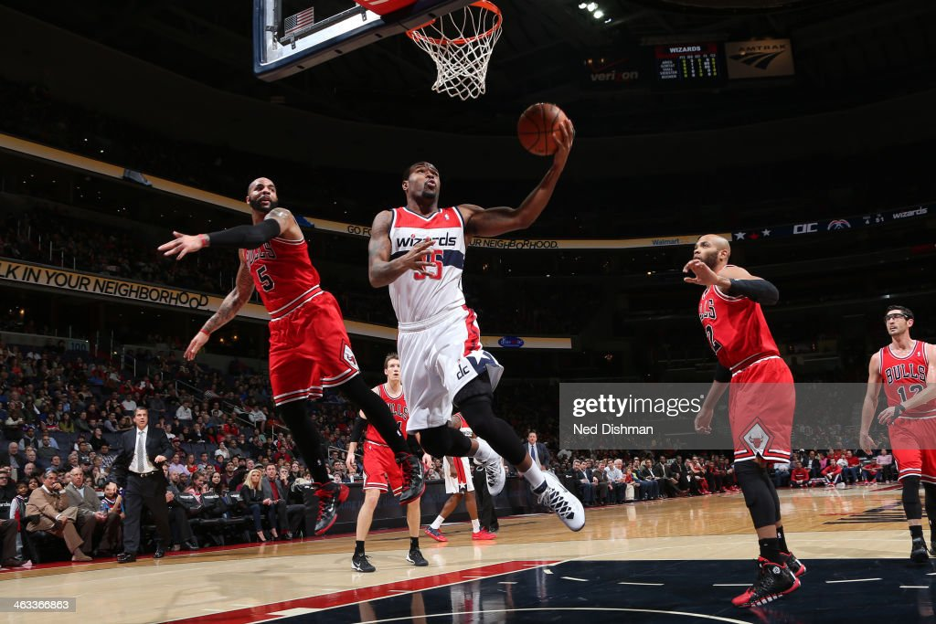 Trevor Booker of the Washington Wizards shoots against Carlos Boozer of the Chicago Bulls during the game at the Verizon Center on January 17 2014 in...