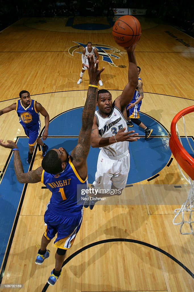 Trevor Booker #35 of the Washington Wizards shoots against <a gi-track='captionPersonalityLinkClicked' href=/galleries/search?phrase=Dorell+Wright&family=editorial&specificpeople=211344 ng-click='$event.stopPropagation()'>Dorell Wright</a> #1 of the Golden State Warriors at the Verizon Center on March 2, 2011 in Washington, DC.
