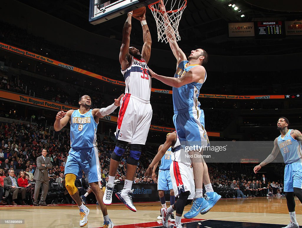 <a gi-track='captionPersonalityLinkClicked' href=/galleries/search?phrase=Trevor+Booker&family=editorial&specificpeople=4123563 ng-click='$event.stopPropagation()'>Trevor Booker</a> #35 of the Washington Wizards shoots against <a gi-track='captionPersonalityLinkClicked' href=/galleries/search?phrase=Kosta+Koufos&family=editorial&specificpeople=4216032 ng-click='$event.stopPropagation()'>Kosta Koufos</a> #41 and <a gi-track='captionPersonalityLinkClicked' href=/galleries/search?phrase=Andre+Iguodala&family=editorial&specificpeople=201980 ng-click='$event.stopPropagation()'>Andre Iguodala</a> #9 of the Denver Nuggets during the game at the Verizon Center on February 22, 2013 in Washington, DC.