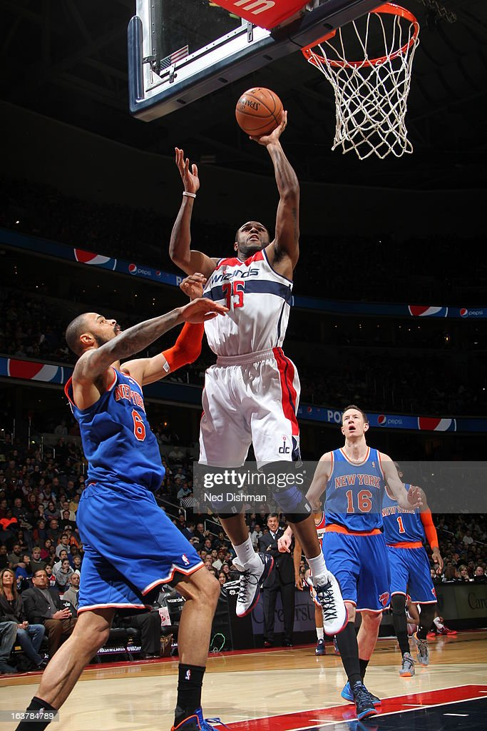 <a gi-track='captionPersonalityLinkClicked' href=/galleries/search?phrase=Trevor+Booker&family=editorial&specificpeople=4123563 ng-click='$event.stopPropagation()'>Trevor Booker</a> #35 of the Washington Wizards shoots against <a gi-track='captionPersonalityLinkClicked' href=/galleries/search?phrase=Tyson+Chandler&family=editorial&specificpeople=202061 ng-click='$event.stopPropagation()'>Tyson Chandler</a> #6 of the New York Knicks at the Verizon Center on March 1, 2013 in Washington, DC.