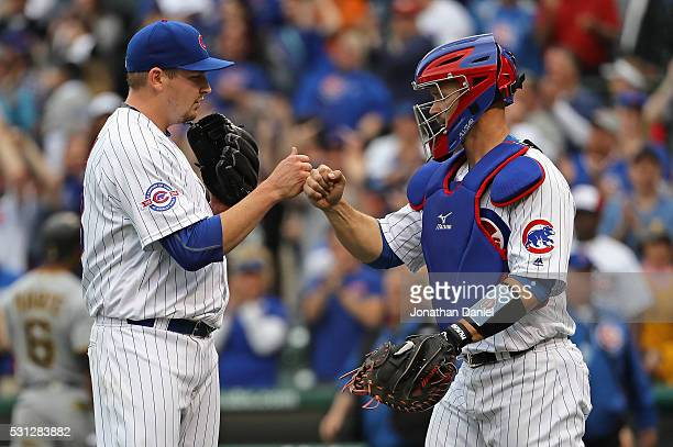 Trevor Cahill and David Ross of the Chicago Cubs celebrate a win against the Pittsburgh Pirates at Wrigley Field on May 13 2016 in Chicago Illinois...