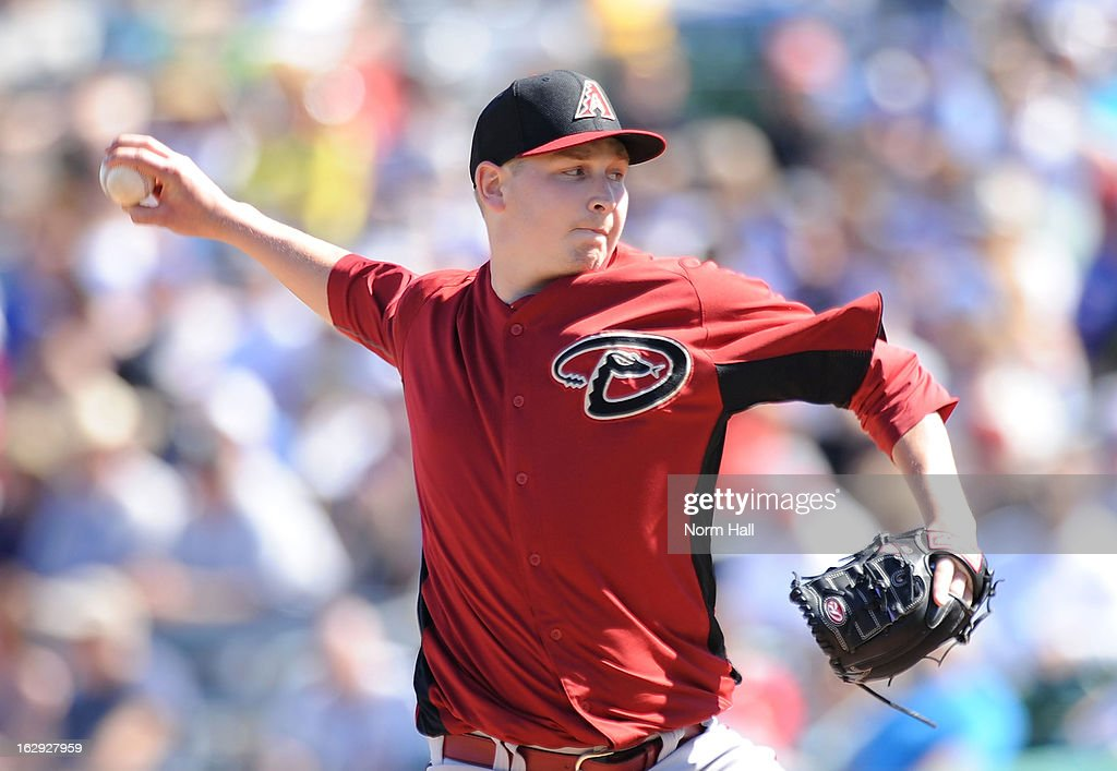 <a gi-track='captionPersonalityLinkClicked' href=/galleries/search?phrase=Trevor+Cahill&family=editorial&specificpeople=5437061 ng-click='$event.stopPropagation()'>Trevor Cahill</a> #35 of the Arizona Diamondbacks delivers a pitch against the Chicago Cubs at Hohokam Stadium on March 1, 2013 in Mesa, Arizona.