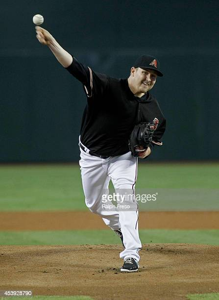 Trevor Cahill of the Arizona Diamondbacks delivers a pitch against the Colorado Rockies during the first inning of an MLB game at Chase Field on...