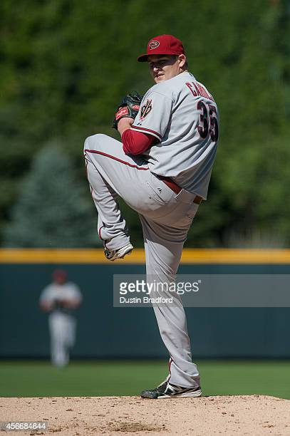 Trevor Cahill of the Arizona Diamondbacks pitches against the Colorado Rockies in the first inning of a game at Coors Field on September 20 2014 in...