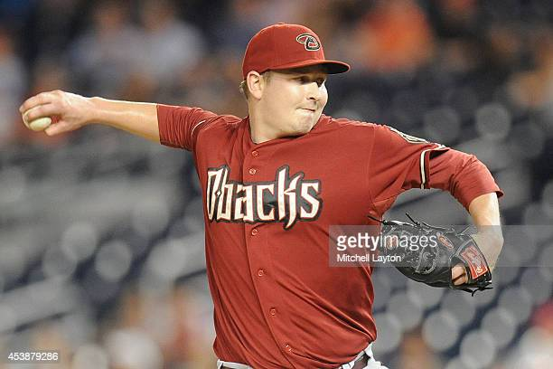 Trevor Cahill of the Arizona Diamondbacks pitches in the third inning during a baseball game against the Washington Nationals on August 20 2014 at...